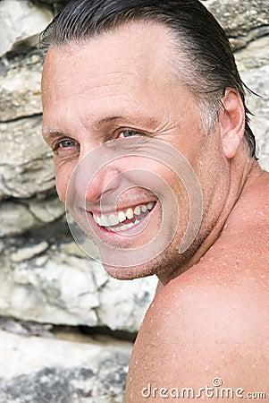 Happy man on the beach