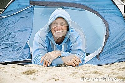 Happy man camping