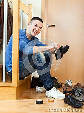 Happy man  cleaning footwear