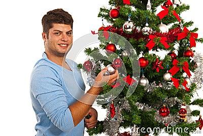 Happy man decorate Christmas tree