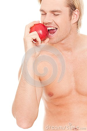 Happy man eating an apple