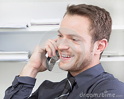 Happy man flirting on phone