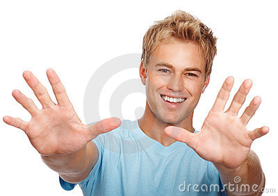 Happy man gesturing with hands on white