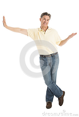 Happy Man Gesturing While Leaning Over White Background
