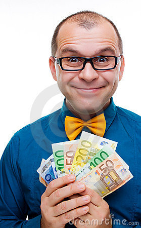 Happy man with handful of money