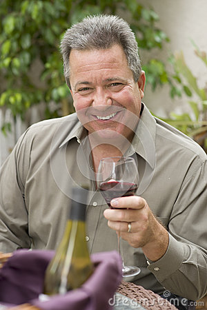 Happy Man Holding Glass of Wine