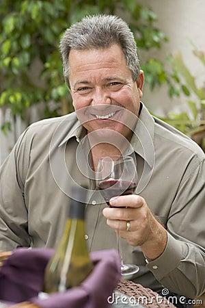 Happy Man Holding Glass of Wine