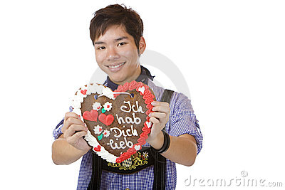 Happy man holding Oktoberfest heart