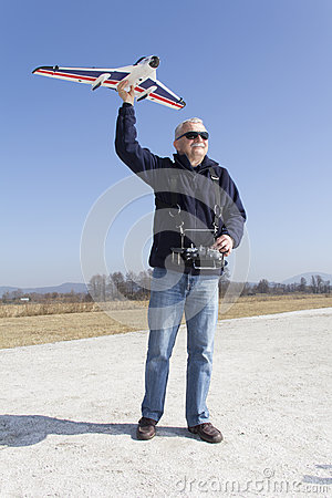 Happy man launching a RC plane