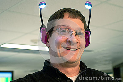 Happy Man With Lights on Ears