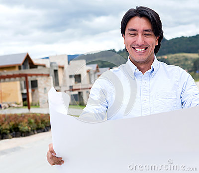Happy man looking at blueprints