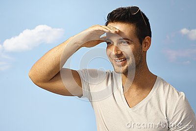 Happy man looking at distance at summertime