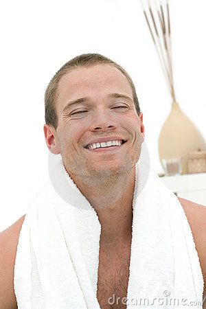 Happy man recieving spa treatment