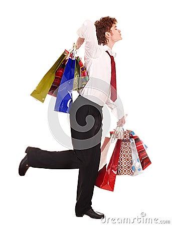 Happy man with shopping bag run.