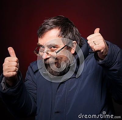 Happy man shows ok sigh