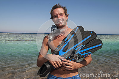 Happy man with snorkel mask and finns