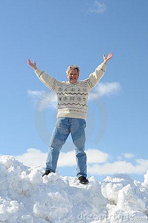 Happy man on a snow hill