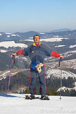Happy man in snowshoe