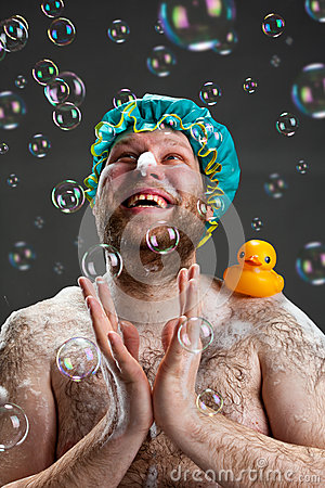 Happy man and soap bubbles