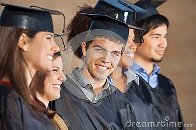 Happy Man Standing With Students On Graduation Day