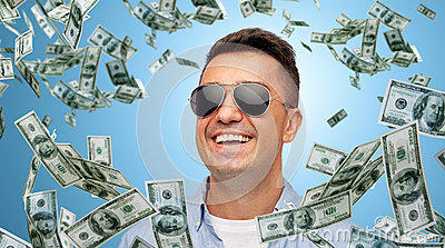 Happy man in sunglasses with falling dollar money Stock Photo
