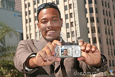 Happy Man Taking His Self Portrait With a Pocket C