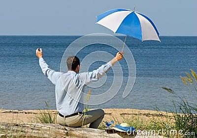 Happy man with umbrella