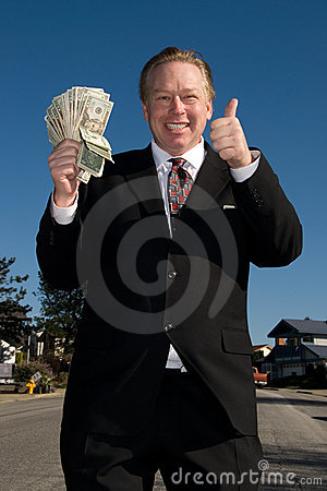 Happy man with wad of cash.