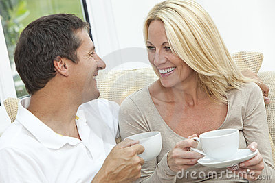 Happy Man & Woman Couple Drinking Tea or Coffee