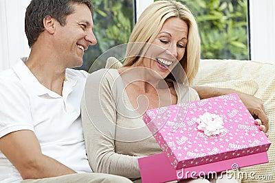 Happy Man & Woman Couple Opening Birthday Present