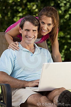 Happy Man and Woman Couple Using Laptop Computer