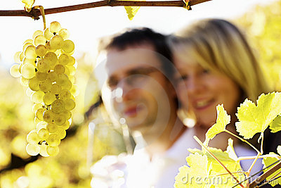 Happy man and woman in vineyard.