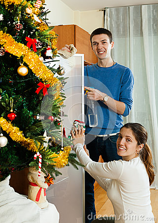 Happy man and woman wiping dust