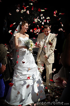 Happy marriage with rose petals.