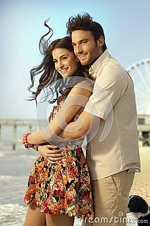 Happy married couple on honeymoon trip at beach