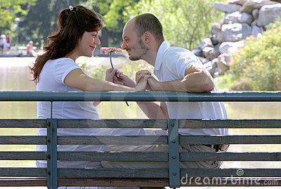 Happy married couple sitting on a bench