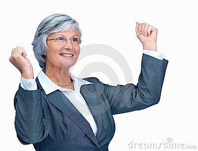 Happy mature business lady with hands raised
