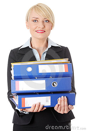 Happy mature business woman s holding documents.