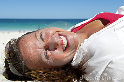 Happy Mature and Confident Woman at Ocean