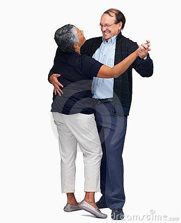 Happy mature couple dancing over white background