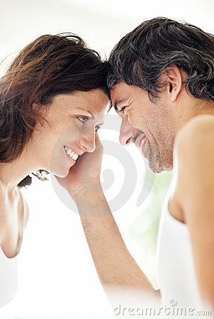 Happy mature couple looking face to face