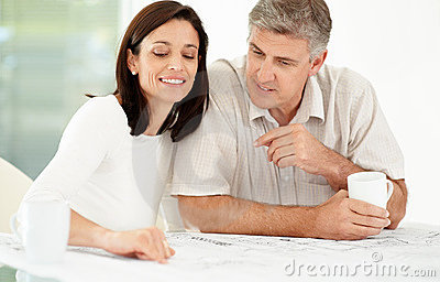 Happy mature couple looking over paperwork