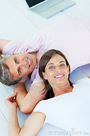 Happy mature couple lying down together
