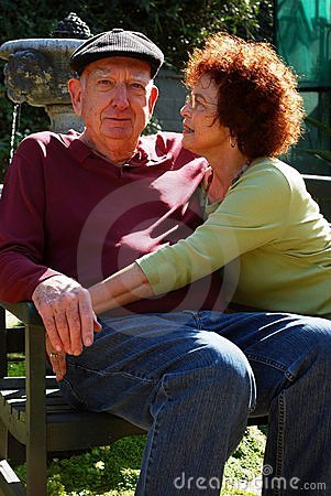 A happy mature couple relaxes in the sun