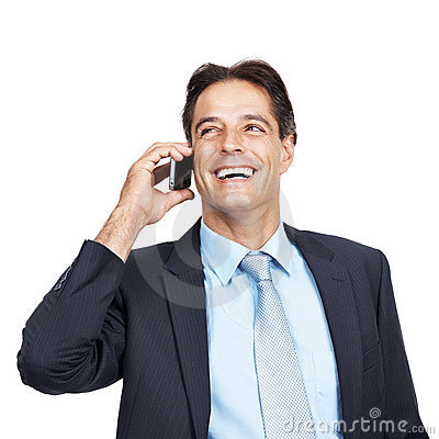 Happy mature executive on cellphone
