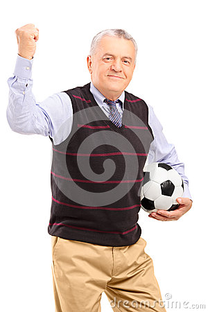 A happy mature fan with football gesturing with his hand