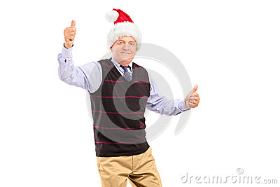 Happy mature gentleman with hat giving thumbs up