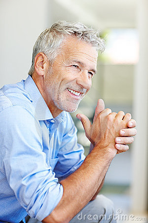 Happy mature male entrepreneur smiling