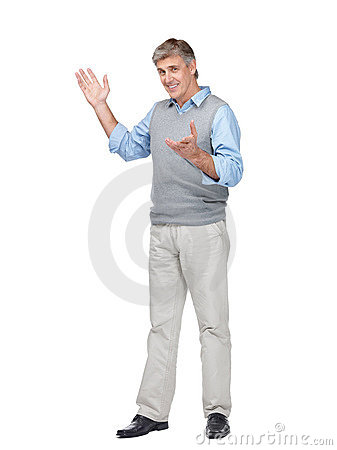 Happy mature man gesturing at copyspace