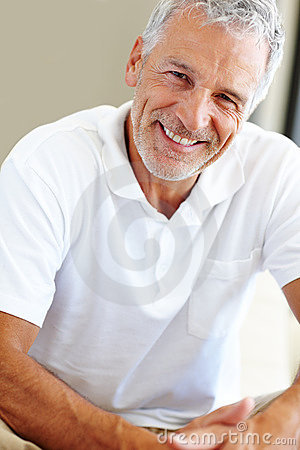 Happy mature man sitting comfortably
